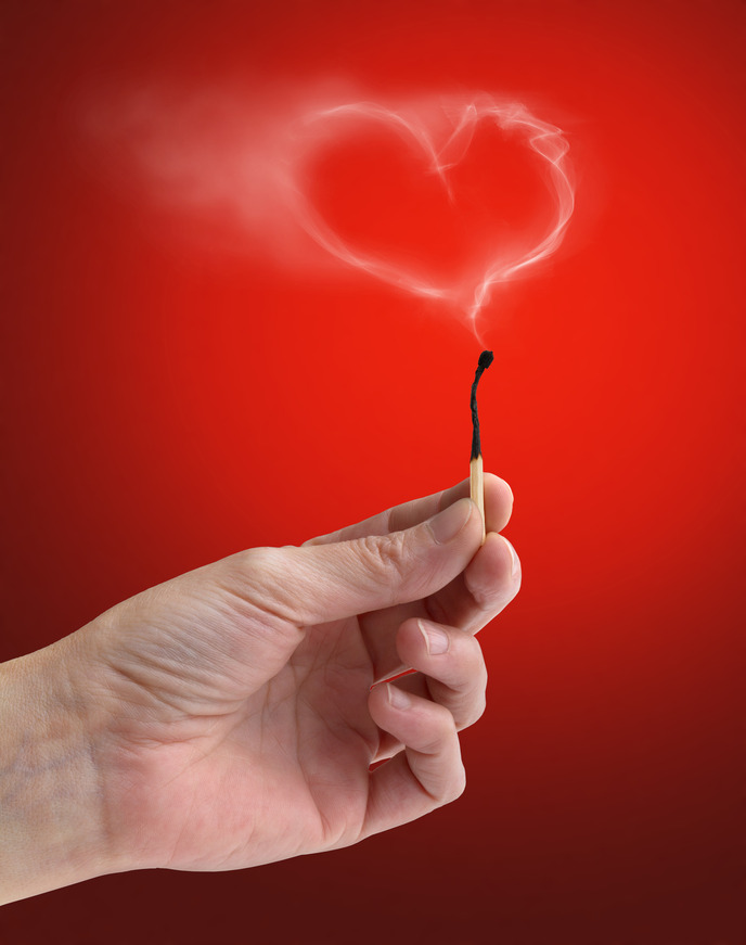 extinguished matchstick with a wisp of smoke heart-shaped